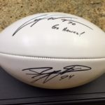 Jared DeVries and Casey Wiegmann Autographed football